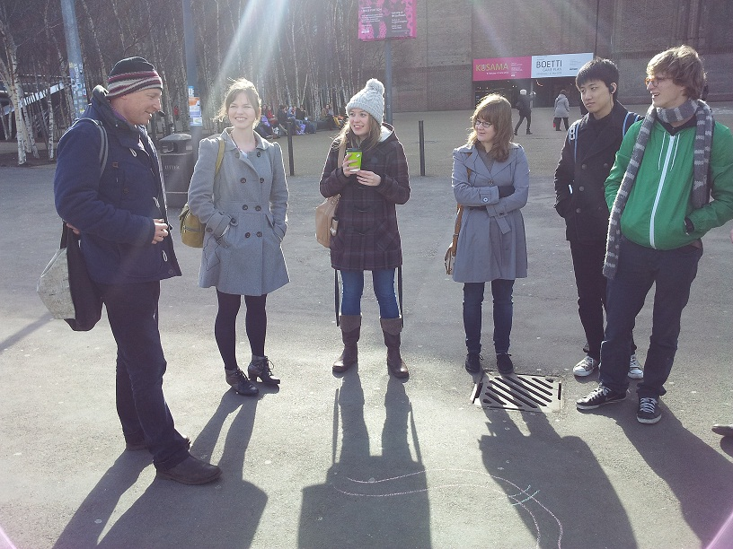 Marcus du Sautoy discussing maths with tour guides outside the Tate Modern